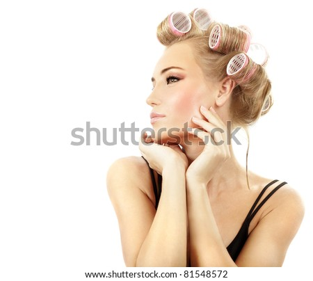 Stylish girl portrait with fashion makeup and hair curlers, isolated on white background, hair and beauty treatment concept - stock photo