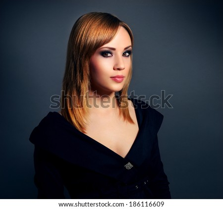 Stylish girl with beautiful makeup on black background