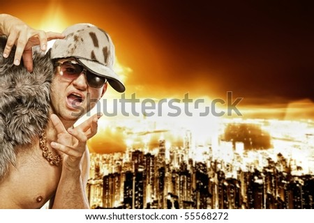 Stylish glamorous rapper in front of modern night city - stock photo