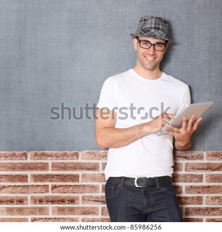 Stylish guy using electronic tablet - stock photo