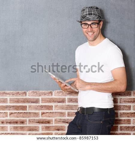 Stylish guy using electronic tablet