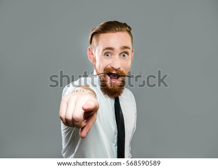 stylish guy with long antennae shows finger forward