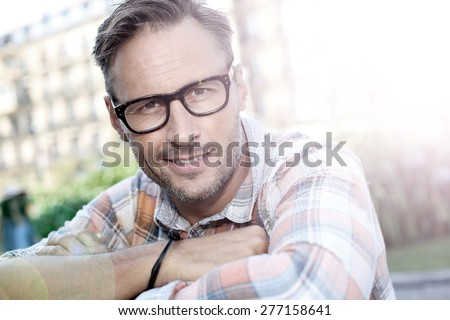 Stylish handsome man in urban scene - stock photo