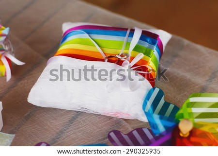 stylish hawaiian colorful decorated pillow with rings  on cyprus - stock photo