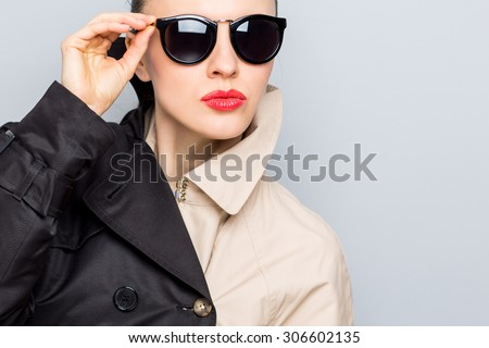 Stylish lady in sunglasses and rain coat