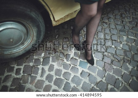 stylish lady standing on the background of your car - stock photo