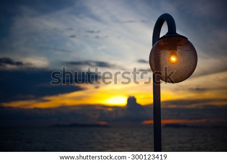stylish lamp at night on sunset sky background - stock photo