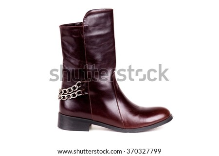Stylish leather boots shot in studio, isolated on white