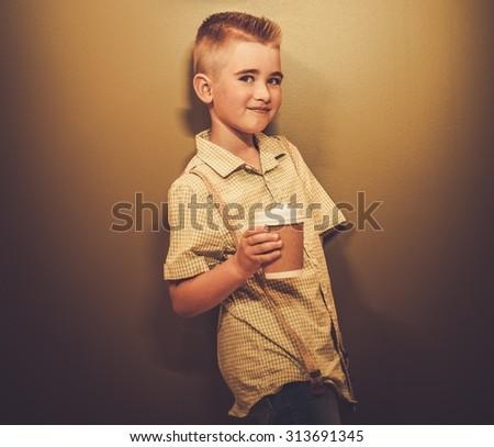 Stylish little boy with coffee mug  - stock photo