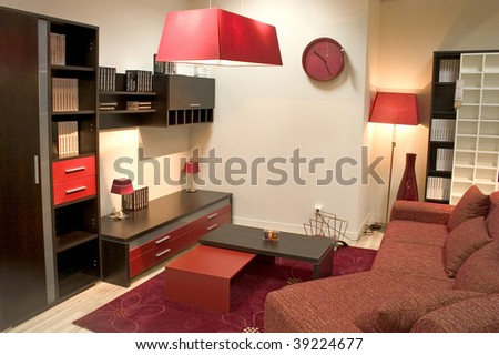 Stylish living room in red and brown colors. - stock photo