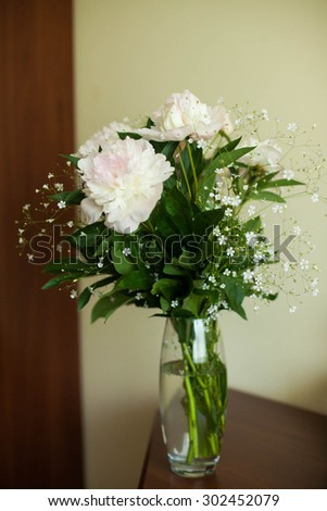 stylish luxury cute    bouquet of white  peonies  in the vase on the background room - stock photo