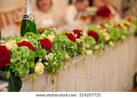 stylish luxury golden decorative centerpiece table with roses for the celebration for a wedding, cathering in the restaurant - stock photo