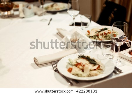 stylish luxury table with food and drinks at elegant celebration, catering in restaurant - stock photo