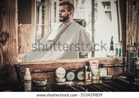 Stylish man in a barber shop - stock photo
