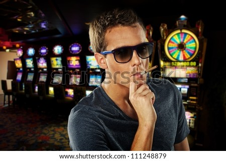 Stylish man in a casino - stock photo