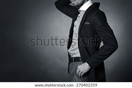 Stylish man in an elegant suit. - stock photo