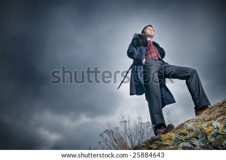 Stylish man over sky background, low angle view