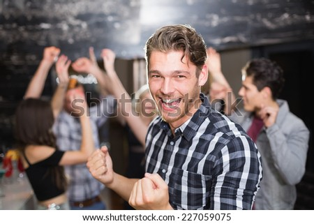 Stylish man smiling and dancing at the bar - stock photo