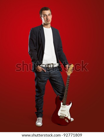 stylish man with guitar looking at camera against different backgrounds