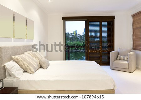 Stylish master bedroom in luxury home - stock photo
