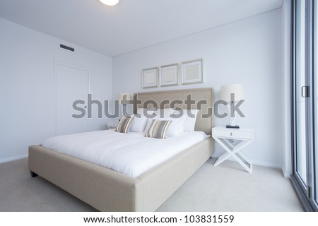Stylish master bedroom in new Australian apartment. - stock photo