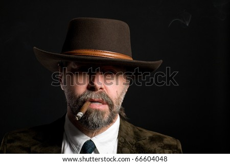 Stylish middle aged man with a cigar. - stock photo