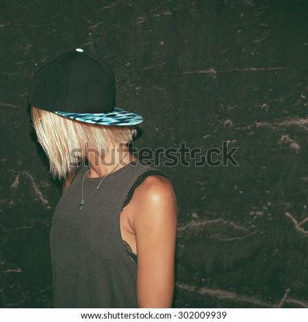 Stylish Model in fashionable Cap. Urban Fashion style - stock photo