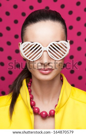 Stylish model posing in colorful wear and accessories. Shutter Shade sunglasses - stock photo