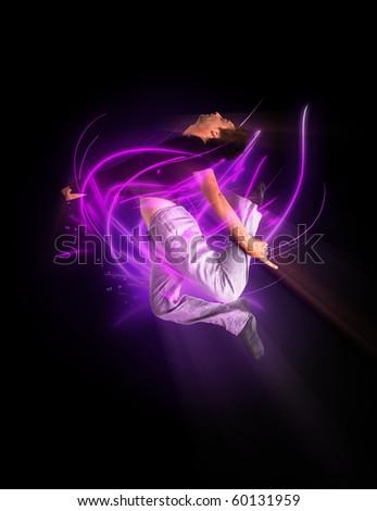 stylish modern ballet dancer jumping on black - stock photo