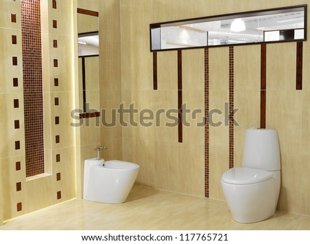Stylish modern bathroom with sink and toilet - stock photo