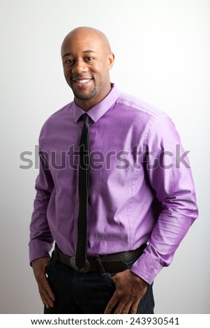 Stylish modern business man wearing a shirt and skinny black tie. - stock photo