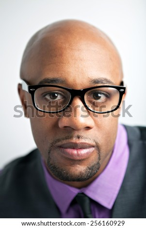 Stylish modern business man wearing black framed glasses. - stock photo
