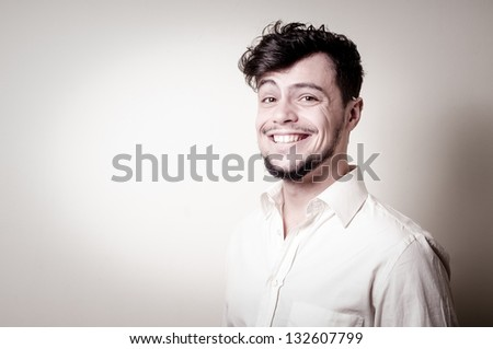 stylish modern guy with white shirt on gray background
