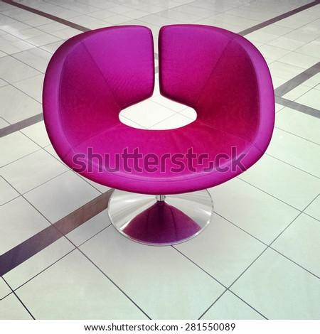 Stylish modern purple chair on ceramic floor. - stock photo