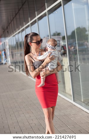 Stylish mother and baby - stock photo