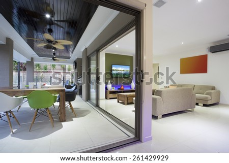 Stylish open home interior with colorful furniture and LED lights - stock photo