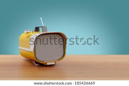 Stylish orange retro TV mobile sixties, on a table - stock photo