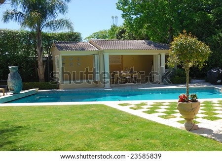 Stylish outdoor terrace with swimming pool - stock photo