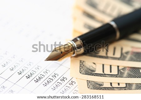 Stylish pen near USA cash on paper background with digits