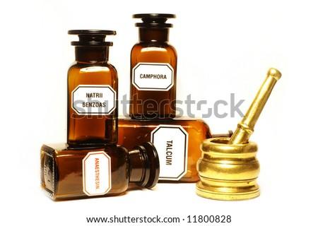 Stylish pharmacy bottles and mortar, isolated - stock photo