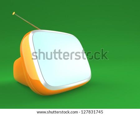 stylish portable retro TV in green background - stock photo