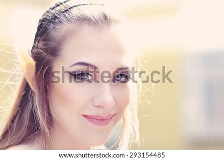 Stylish portrait of a beautiful young girl elf princess magical fashion toning - stock photo