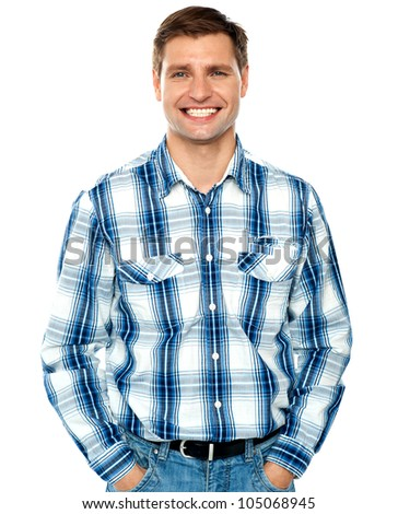 Stylish portrait of a handsome guy posing with hands in pocket - stock photo