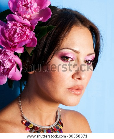 stylish portrait of beautiful young woman with art make up and flowers - stock photo