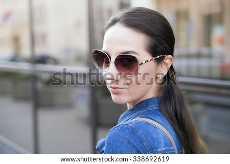 Stylish Pretty Young Woman in Autumn Fashion walking the city  - stock photo
