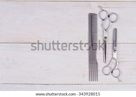 Stylish Professional Barber Scissors, Hair Cutting and Thinning Scissors  and comb on white background. Hairdressing Set. Haircut accessories. Copy space image, flat lay - stock photo