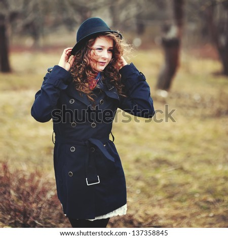 stylish red hair girl in hat and coat, autumn portrait