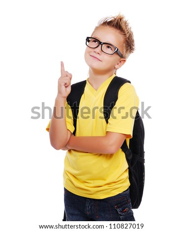 Stylish schoolboy closeup portrait pointing to the copy space area