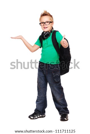 Stylish schoolboy with a bag and headphones full length portrait making a presenting gesture - stock photo