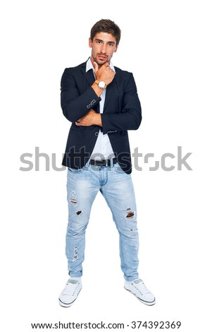 Stylish seriously man holding chin, looking at the camera. Isolated on white background - stock photo